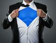 Leinwanddruck Bild - Young businessman acting like a super hero