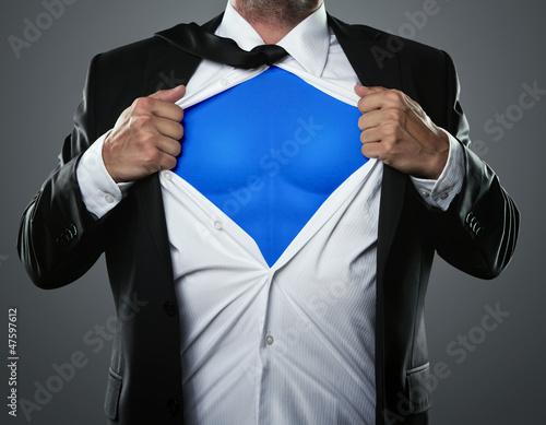 Leinwanddruck Bild Young businessman acting like a super hero