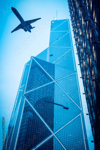 airliner and modern glass building
