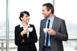 Businessman and businesswoman drinking coffee