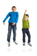 Two boys jumping on white background.