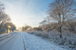 Snowy road through the countryside