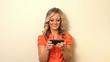 Smiling blond business woman sending text message
