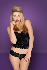 Glamorous blonde in lacy black lingerie
