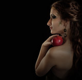 Portrait seductive posing girl with apple