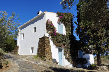 Typical Mediterranean house with a bougainvillea in Costa Brava