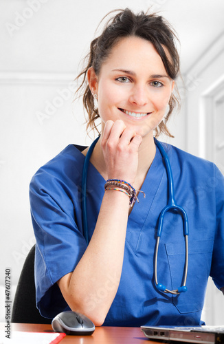 Nurse sitting at desk at work