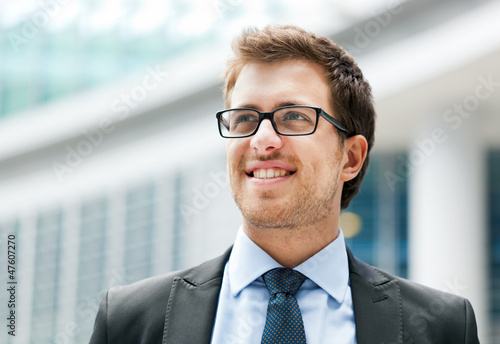 Smiling outdoor businessman