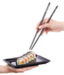 Sushi - Roll  with chopsticks isolated