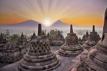 Borobudur temple and mountain at sunrise