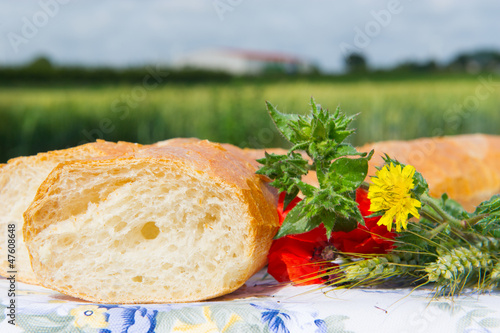 Fresh bread and grain ears outdoor