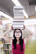 Girl student carry books on head