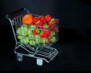Shopping cart full of fresh fruit