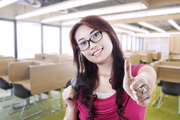 Girl student thumb up in class