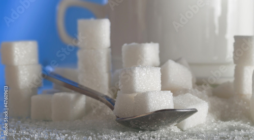 sugar cubes around the white cup (shallow dof)
