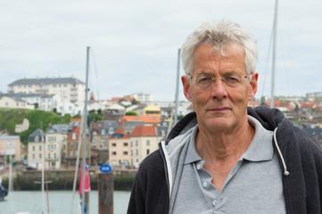 Elder man in harbor