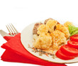Fried meatballs with cauliflower and tomato on a nice plate
