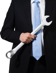 Manager holding wrench