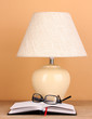 table lamp and glasses on beige background