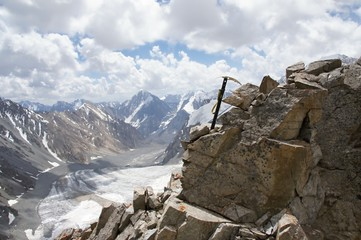 Ice axe in rock over glacier Dugoba, Pamir-alay, Kyrgyzstan
