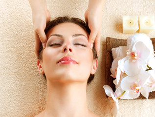 Spa Massage. Young Woman Getting Facial Massage