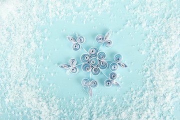 beautiful paper snowflake, on blue background