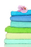 Fototapety Stack of towels with fragrant flower isolated on white