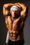 Muscular man wearing a Middle Eastern headdress poster