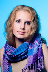 Close-up portrait of a charming girl with a scarf