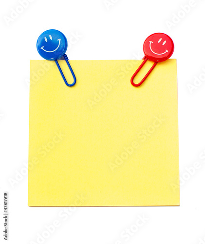 Note with smiling paper clips
