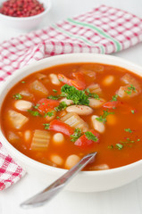baked soup with beans, celery and bell pepper closeup
