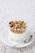 Yogurt and granola in a small glass beaker portions