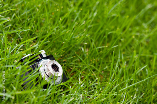 SLR camera on green grass