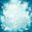 Christmas blue background with christmas tree branches and snowf