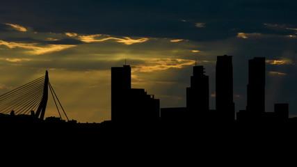 Netherlands Rotterdam skyline sunbeams