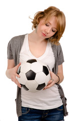 Young blonde girl holding a soccerball