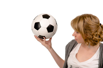 Attractive blonde woman with a football