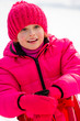 Little girl have fun on sled