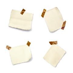 Petits morceaux de toile sur fond blanc tenu par de l'adhésif