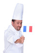 Cook holding French flag