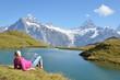 Traveler in the Alpine meadow. Jungfrau region, Switzerland