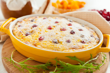 Cheese casserole with cranberries and raisins in dish