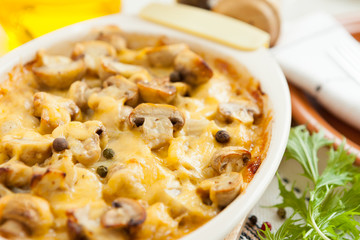 Vegetables Pie with mushrooms, potatoes and cheese closeup