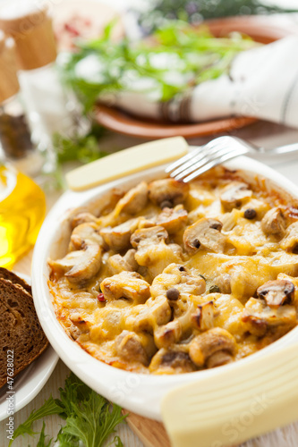 Baked vegetables. Mushrooms, potatoes and cheese