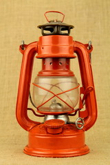 Red oil lamp on burlap