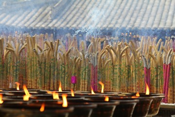 Incense burning in a temple, with candles.
