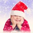 Weihnachtsmännchen wird eingeschneit