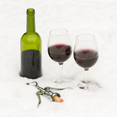 Bottle of red wine and wineglasses isolated