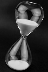 Hourglass on black background.