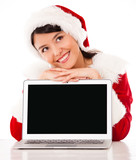 Thoughtful female Santa with laptop